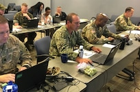 Members from Joint Task Force Civil Support become students as they learn a program for online collaboration with a goal to enhance the organization's unity of effort Sept. 5 at Mullan Hall. A top priority of JTF-CS' commanding general, U.S. Army Maj. Gen. Bill Hall, such unity allows responders to communicate effectively during Defense Support of Civil Authority and helps reduce the fog and friction that occurs when responding to complex catastrophic events. (DoD photo by Lt. Col. Karen Roganov)