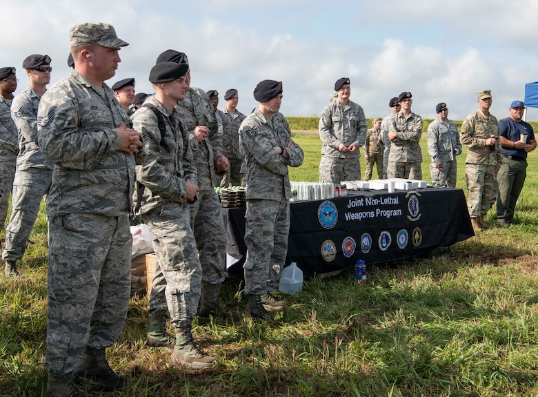 Members from local police department, local sheriff's department, 126th Air Refueling Wing, 375th Security Forces Squadron, and the 375th Logistics Readiness Squadron learn about the M203 40mm grenade launcher during the Non-Lethal Weapons Familiarization event Aug. 30, 2018, at the Illinois National Guard Training Area in Sparta, Illinois.