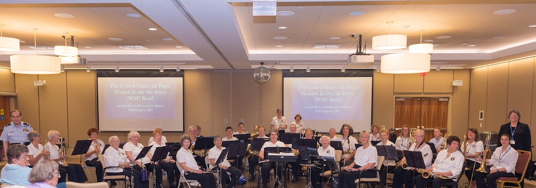 The WAF Band poses for a photo with current members of the USAF Band and Col Arnald D. Gabriel (ret.)