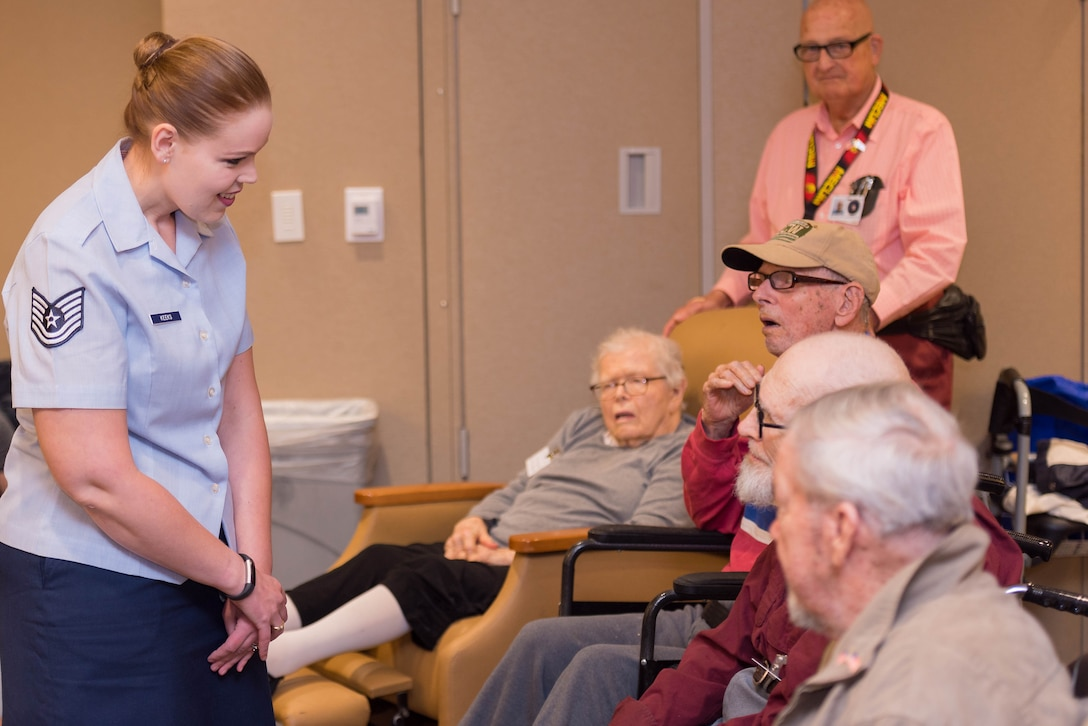 Technical Sgt. Ashley Keeks speaks with members from the Armed Forces Retirement Home during a recent performance by members of the WAF Band and U.S. Air Force Band