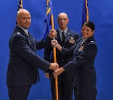 Col. Shawn Covault, 375th Mission Support Group commander, presents the 375th Logistics Readiness Squadron guidon to Lt. Col. Jennifer Kennedy during an assumption of command ceremony on Scott Air Force Base, Illinois, Sept. 4, 2018. Kennedy is a Pensacola, Florida, native and arrives to the 375th LRS from U.S. Central Command.