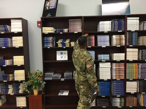 Image of  a customer browsing books in the Air University Press bookstore