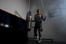 "Cpl. Oubigee Jones stands in the gym where he trains nearly every day aboard Marine Corps Air Station Beaufort, Aug. 30. Jones began fighting when he was eight years old. ""I grew up in the streets of south Dallas, the hood basically. Everyone started fighting at a young age, whether it be to defend themselves or to earn their stripes."" Jones is an administrative specialist with Headquarters and Headquarters Squadron."