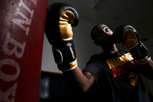 """Cpl. Oubigee Jones stands in the gym where he trains nearly every day aboard Marine Corps Air Station Beaufort, Aug. 30. Jones began fighting when he was eight years old. """"I grew up in the streets of south Dallas, the hood basically. Everyone started fighting at a young age, whether it be to defend themselves or to earn their stripes."""" Jones is an administrative specialist with Headquarters and Headquarters Squadron."""