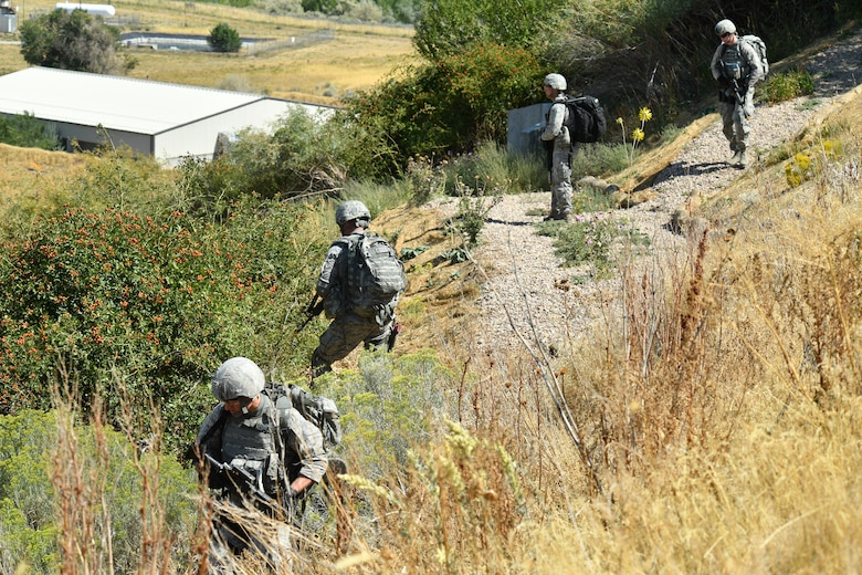 Security forces defenders during a training patrol Sept. 7, 2018, at Hill Air Force Base, Utah. A total of six Airmen were selected from across Air Force Material Command to represent the command at the 2018 Defender Challenge Sept. 10-14 at Camp Bullis Military Training Reservation, near San Antonio, Texas. The team will compete against 13 other teams from other U.S. Air Force major commands, Great Britain and Germany in the first 2018 Defender Challenge since 2004. (U.S. Air Force photo by R. Nial Bradshaw)