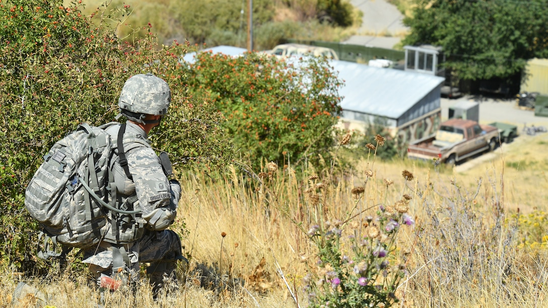 Master Sgt. Leif Gisselberg, a security forces defender from the Air Force Research Lab, Det. 15, Hawaii, overlooks a mock village during a training patrol Sept. 7, 2018, at Hill Air Force Base, Utah. Gisselberg was one of six Airmen selected to the security forces team representing Air Force Material Command at the 2018 Defender Challenge Sept. 10-14 at Camp Bullis Military Training Reservation, near San Antonio, Texas. The team will compete against 13 other teams from other U.S. Air Force major commands, Great Britain and Germany in the first 2018 Defender Challenge since 2004. (U.S. Air Force photo by R. Nial Bradshaw)