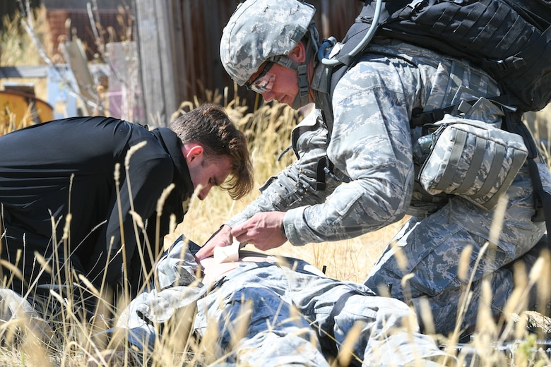 Tech. Sgt. Jakob Hasse (right), a security forces defender from the 72nd Security Forces Squadron, Tinker Air Force Base, Okla., during a self-aid buddy care simulation Sept. 7, 2018, at Hill AFB, Utah. Hasse was one of six Airmen selected to the security forces team representing Air Force Material Command at the 2018 Defender Challenge Sept. 10-14 at Camp Bullis Military Training Reservation, near San Antonio, Texas. The team will compete against 13 other teams from other U.S. Air Force major commands, Great Britain and Germany in the first 2018 Defender Challenge since 2004.  (U.S. Air Force photo by Cynthia Griggs)