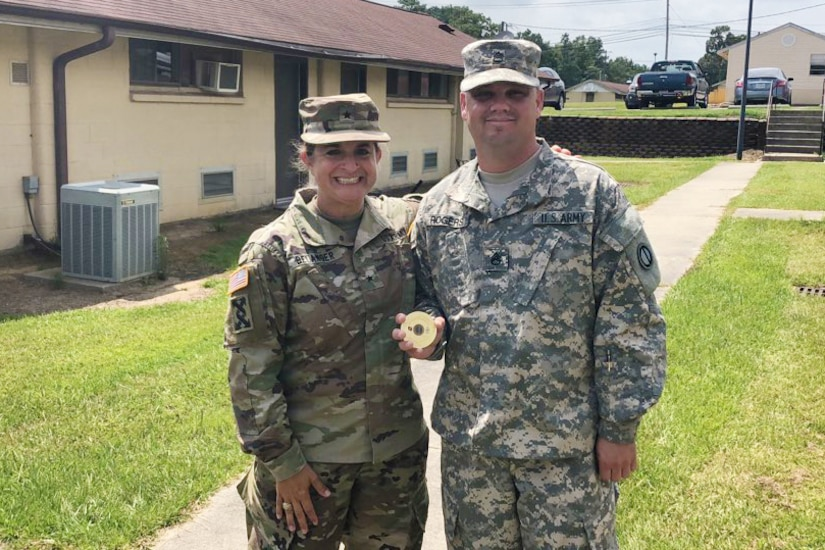 U.S. Army Reserve Brig. Gen. Kris A. Belanger, left, commanding general of the 85th Support Command pauses for a photo with Staff Sgt. Joel Rogers, assigned to the 2-346th Training Support Battalion, 85th Support Command, at Camp Shelby, Mississippi, July 22, 2018.