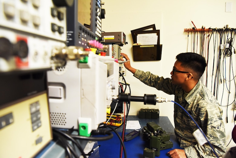 Airman Johnrafael Pena, a 28th Communications Squadron radio frequency technician, uses a distortion analyzer at Ellsworth Air Force Base, S.D., Sept. 5, 2018. The radio maintenance shop is responsible for maintaining and repairing many of the land mobile radios.  They also maintain the base's mass communication system and also set up and operate public address equipment for community events. (U.S. Air Force photo by Airman 1st Class Thomas Karol)