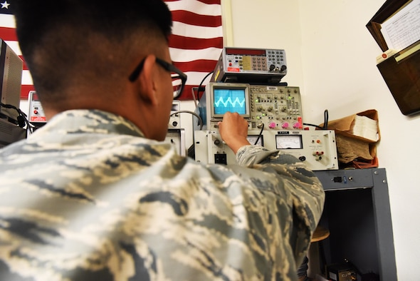 Airman Johnrafael Pena, a 28th Communications Squadron radio frequency technician, uses an oscilloscope at Ellsworth Air Force Base, S.D., Sept. 5, 2018. The radio maintenance shop conducts repairs for radios on base to ensure they will work properly when needed. (U.S. Air Force photo by Airman 1st Class Thomas Karol)