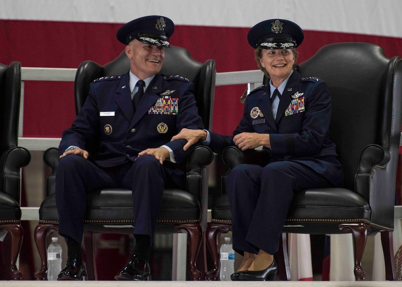 Gen. Carlton D. Everhart II, outgoing Air Mobility Command commander, and Gen. Maryanne Miller, incoming AMC commander, share a moment during the AMC change of command, Scott Air Force Base, Illinois, Sept. 7, 2018. Miller assumed command from Everhart, who retires after 35 years of service to the Air Force. AMC provides rapid, global mobility and sustainment for America's armed forces through airlift, aerial refueling, aeromedical evacuation and mobility support. (U.S. Air Force photo by Tech. Sgt. Jodi Martinez)