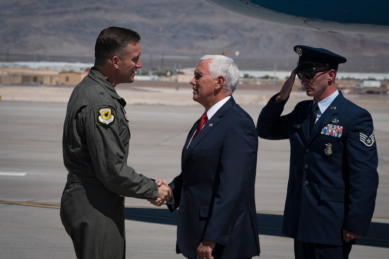 Vice President Mike Pence is greeted by Brig. Gen. Robert Novotny, 57th Wing commander, upon arriving at Nellis Air Force Base, Nevada, Sept. 7, 2018. Upon landing, Novotny and other base leaders escorted Pence to the flightline to converse with the Airmen. (U.S. Air Force photo by Airman 1st Class Andrew D. Sarver)