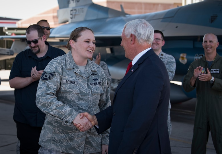 Vice President Mike Pence congratulates Tech. Sgt. Vanessa Redman, 32nd Weapons Squadron NCO in charge, on her Stripes for Exceptional Performers (STEP) promotion moments prior at Nellis Air Force Base, Nevada, Sept. 7, 2018. Pence and Brig. Gen. Robert Novotny, 57th Wing commander, surprised her with the promotion during Pence's visit. (U.S. Air Force photo by Airman 1st Class Andrew D. Sarver)