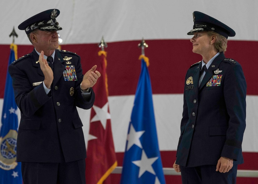 Air Force Chief of Staff Gen. David L. Goldfein claps for Gen. Maryanne Miller after she assumed command of Air Mobility Command, Scott Air Force Base, Illinois, Sept. 7, 2018. Miller assumed command from Gen. Carlton D. Everhart II, who retires after 35 years of service to the Air Force. AMC provides rapid global air mobility and sustainment for America's armed forces through airlift, aerial refueling, aeromedical evacuation and mobility support.  (U.S. Air Force photo by Tech. Sgt. Jodi Martinez)