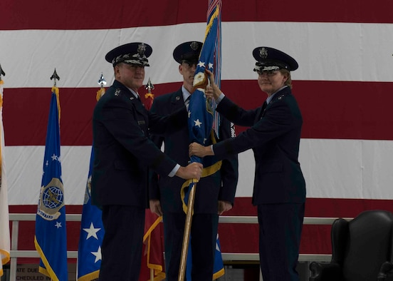 Air Force Chief of Staff Gen. David L. Goldfein passes the Air Mobility Command guidon to Gen. Maryanne Miller, who assumed command of AMC, Scott Air Force Base, Illinois, Sept. 7, 2018. Miller assumed command from Gen. Carlton D. Everhart II, who retires after 35 years of service to the Air Force. AMC provides rapid, global mobility and sustainment for America's armed forces through airlift, aerial refueling, aeromedical evacuation and mobility support. (U.S. Air Force photo by Tech. Sgt. Jodi Martinez)