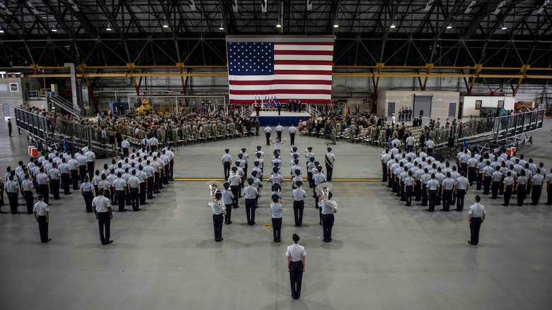Air Force Chief of Staff Gen. David L. Goldfein stands at the front of the stage, preparing to dismiss hundreds of attendees during the Air Mobility Command change of command, where Gen. Maryanne Miller assumed command of AMC, Scott Air Force Base, Illinois, Sept. 7, 2018. Miller assumed command from Gen. Carlton D. Everhart II, who retires after 35 years of service to the Air Force. AMC provides rapid global air mobility and sustainment for America's armed forces through airlift, aerial refueling, aeromedical evacuation and mobility support.  (U.S. Air Force photo by Tech. Sgt. Jodi Martinez)