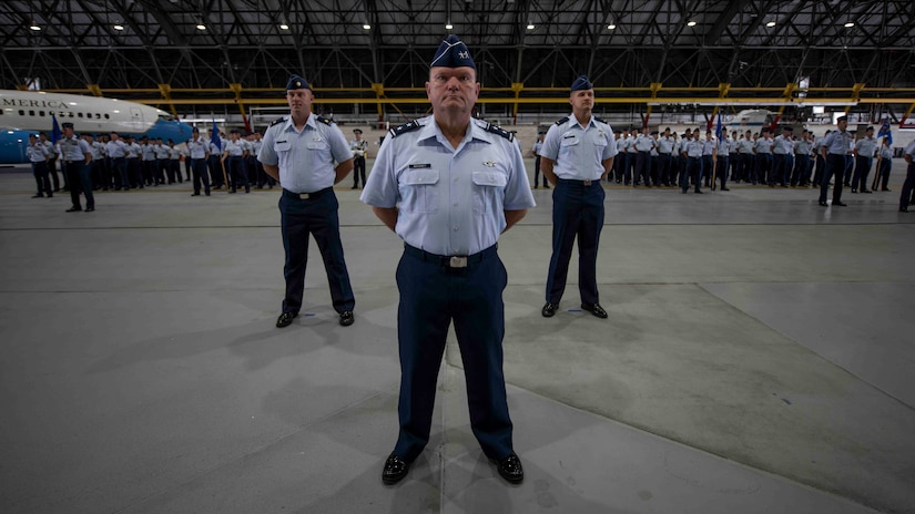 Maj. Gen. Samuel Mahaney, Air Mobility Command chief of staff, stands at parade rest ahead of a four-flight formation for the Air Mobility Command change of command, where Gen. Maryanne Miller will take command of AMC, Scott Air Force Base, Illinois, Sept. 7, 2018. Miller assumed command from Gen. Carlton D. Everhart II, who retires after 35 years of service to the Air Force. AMC provides rapid global air mobility and sustainment for America's armed forces through airlift, aerial refueling, aeromedical evacuation and mobility support. (U.S. Air Force photo by Tech. Sgt. Jodi Martinez)