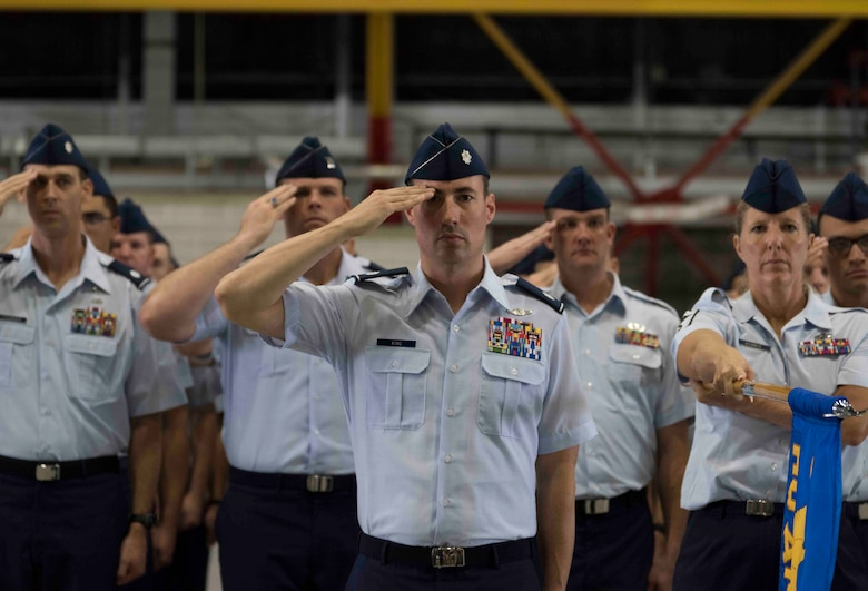 Members of a formation salute as the national anthem plays during Air Mobility Command change of command, Scott Air Force Base, Illinois, Sept. 7, 2018. Gen. Maryanne Miller assumed command from Everhart, who retires after 35 years of service to the Air Force. AMC provides rapid, global mobility and sustainment for America's armed forces through airlift, aerial refueling, aeromedical evacuation and mobility support. (U.S. Air Force photo by Tech. Sgt. Jodi Martinez)