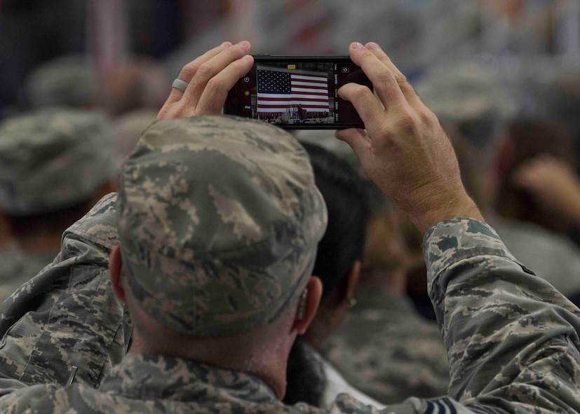 An attendee takes a photo of Gen. Carlton D. Everhart II, Air Mobility Command commander, as he gives his final speech as the AMC commander during the AMC change of command ceremony, Scott Air Force Base, Illinois, Sept. 7, 2018. Gen. Maryanne Miller assumed command from Gen. Carlton D. Everhart II, who retires after 35 years of service to the Air Force. AMC provides rapid global air mobility and sustainment for America's armed forces through airlift, aerial refueling, aeromedical evacuation and mobility support. (U.S. Air Force photo by Tech. Sgt. Jodi Martinez)