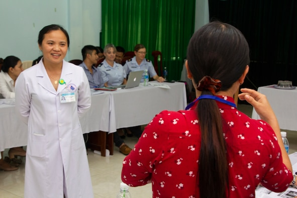 Dr. Nha Thi Nguyen, director of Quang Nam Department of Health, Reproductive Health Care Center, left, takes a question as part of a women and infant health discussion with Vietnamese and U.S. health care professionals during a Pacific Angel 2018 (PACANGEL 18-2) subject matter expert exchange Sept. 6, 2018, in Tam Ky, Quang Nam province, Vietnam.