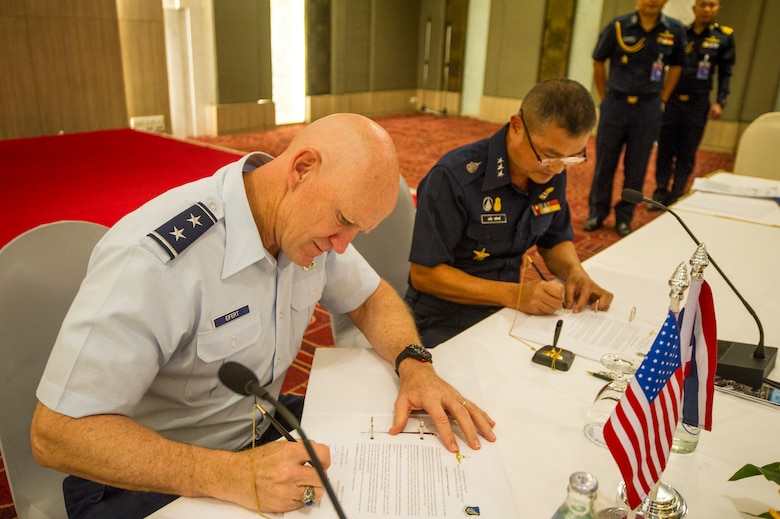 (Left) U.S. Air Force Maj. Gen. James Eifert, Air National Guard assistant to the commander, Pacific Air Forces (PACAF), and (right) Royal Thai Air Forces (RTAF) Air Marshal Maanat Wongwat, Deputy Chief of Air Staff, sign the meeting minutes for the fifth RTAF-PACAF Airman-to-Airman (A2A) talks in Bangkok, Thailand Aug. 22, 2018.