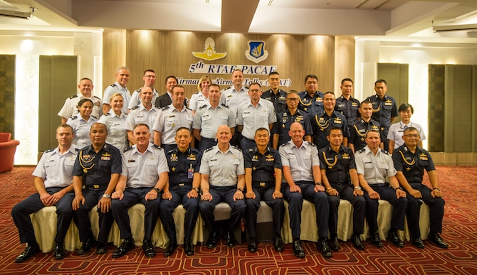 Pacific Air Forces (PACAF) and Royal Thai Air Forces (RTAF) airmen pose for a group photo during the fifth RTAF-PACAF Airman-to-Airman (A2A) talks in Bangkok, Thailand Aug. 21, 2018.