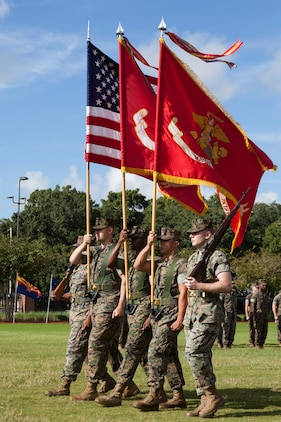 The Marine Forces Reserve and Marine Forces North color guard, march on the colors during the change of command ceremony Sept. 8, 2018, at Marine Corps Support Facility New Orleans. Lt. Gen. Rex C. McMillian, outgoing commander of MARFORRES and MARFORNORTH, relinquished his duties to Maj. Gen. Burke W. Whitman. (U.S. Marine Corps photo by Lance Cpl. Tessa D. Watts)