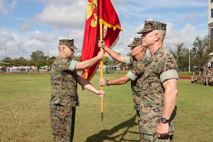 Sgt. Maj. Scott D. Grade, left, sergeant major of Marine Forces Reserve and Marine Forces North, passes the MARFORNORTH colors to Lt. Gen. Rex C. McMillian, outgoing commander of MARFORRES and MARFORNORTH, Sept. 8, 2018, at Marine Corps Support Facility New Orleans.  McMillian relinquished his duties to Maj. Gen. Burke W. Whitman. (U.S. Marine Corps photo by Lance Cpl. Tessa D. Watts)