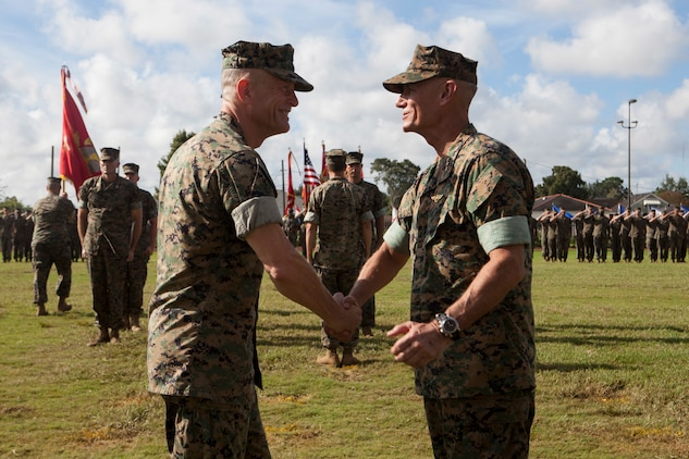 Lt. Gen. Rex C. McMillian, right, outgoing commander of Marine Forces Reserve and Marine Forces North congratulates Maj. Gen. Burke W. Whitman, incoming commander of MARFORRES and MARFORNORTH during the change of command ceremony Sept. 8, 2018, at Marine Corps Support Facility New Orleans. McMillian served as the commander from 2015-2018. (U.S. Marine Corps photo by Lance Cpl. Tessa D. Watts
