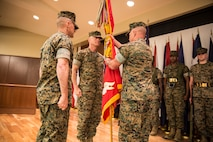 Brig. Gen. Michael S. Martin, right, incoming commanding general of 4th Marine Division, takes the unit colors from Maj. Gen. Burke W. Whitman, outgoing commander of 4th MarDiv, during a change of command ceremony held at Marine Corps Support Facility New Orleans, Sept. 8, 2018. Whitman served as the commanding general of 4th MarDiv from 2017-2018 and will now serve as the commander of Marine Forces Reserve and Marine Forces North. (U.S. Marine Corps photo by Sgt. Melissa Martens)