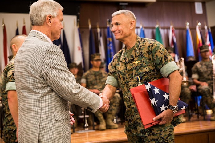 Retired Marine Gen. James F. Amos, 35th Commandant of the Marine Corps, shakes the hand of Lt. Gen. Rex C. McMillian, outgoing commander of Marine Forces Reserve and Marine Forces North, at Marine Corps Support Facility New Orleans, Sept. 8, 2018. Amos was the retiring officer for McMillian, who served almost 40 years in the Marine Corps. (U.S. Marine Corps photo by Sgt. Melissa Martens)