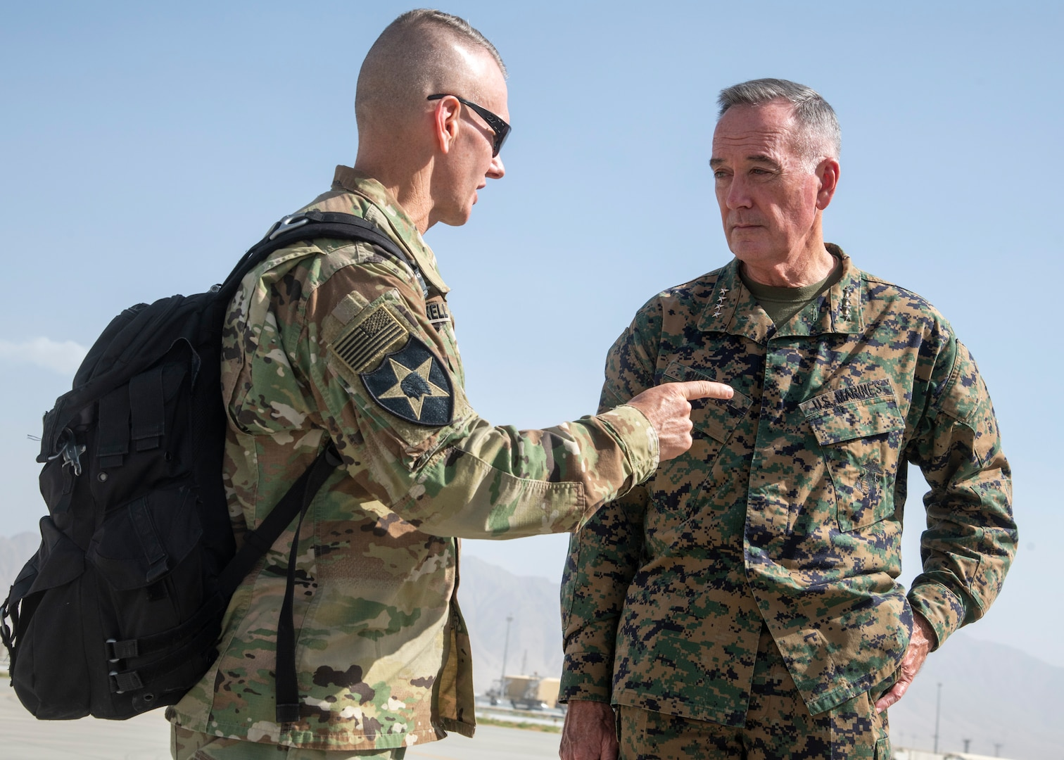 Marine Corps Gen. Joe Dunford, chairman of the Joint Chiefs of Staff, speaks with Army Command Sgt. Maj. John W. Troxell, senior enlisted advisor to the chairman on the Joint Chiefs of Staff at Bagram Airfield, Sept. 7, 2018.