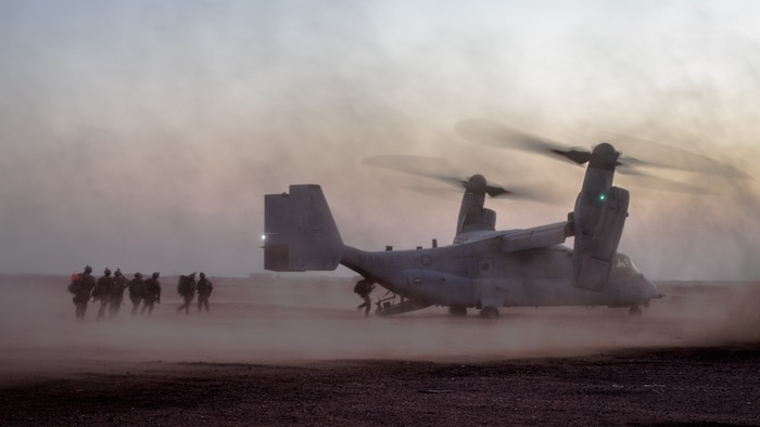 U.S. Marines with India Company, 3rd Battalion 7th Marine Regiment attached to Special Purpose Marine Air-Ground Task Force, Crisis Response-Central Command board an MV-22 Osprey during a tactical recovery of aircraft and personnel exercise August 19, 2018. The exercise provided Marines with realistic training to enhance combat readiness and crisis response skills.
