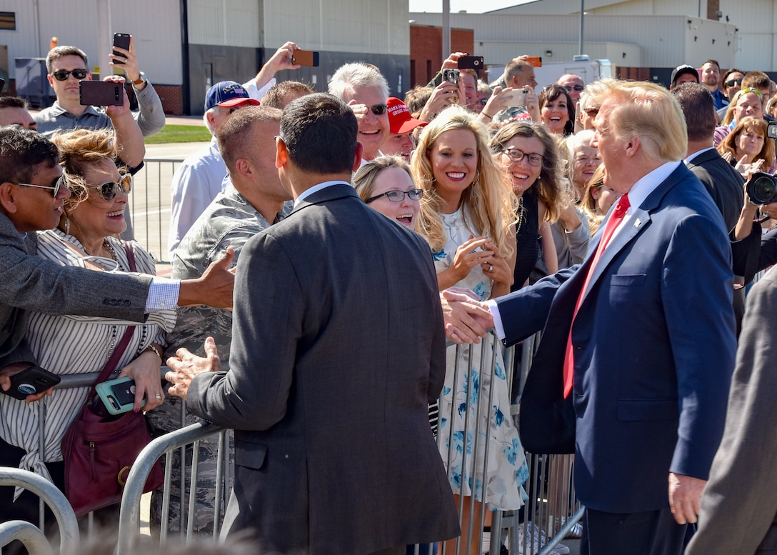 U.S. President Donald J. Trump shakes hands with military members and local community members invited to Joe Foss Field, S.D. for the arrival of Air Force One Sept. 7, 2018.  Trump was in the city to speak at a fundraising event for South Dakota gubernatorial candidate Kristi Noem. (U.S. Air National Guard photo by Tech. Sgt. Luke Olson/Released)