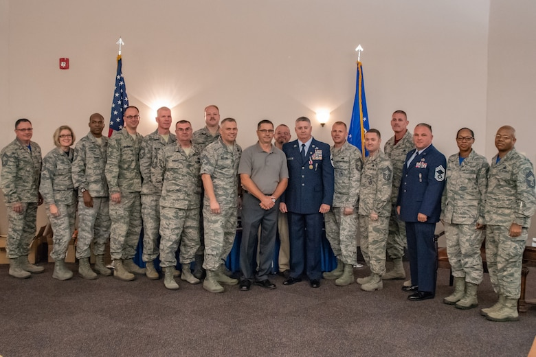 Retired Chief Master Sgt. Steven Vogle poses for a photo with other Chiefs he worked with throughout his career following his retirement ceremony at Barksdale Air Force Base, Sept. 8, 2018. Vogle served more than 34 years in the U.S. Air Force before his retirement. (U.S. Air Force photo by Tech. Sgt. Cody Burt/Released)