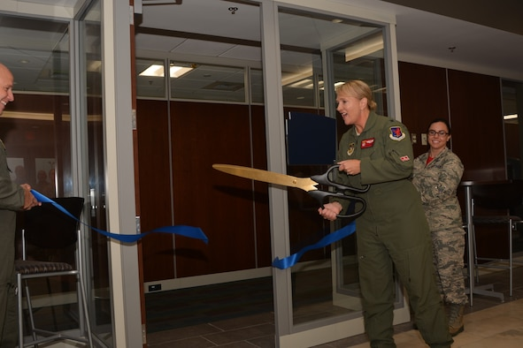 "With a quick motion of oversized scissors, Col. Laurie Dickson, Commander, 513th Air Control Group, officially ""opens"" the new 513th ACG headquarters for business Sept. 7, 2018, at Tinker Air Force Base, Oklahoma. The 513th Air Control Group is the only Air Force Reserve unit to fly and maintain the E-3 Sentry, an Airborne Warning and Control System aircraft that provides surveillance, warning and tactical control of U.S. and allied military aircraft.  As a Reserve associate unit, Airmen assigned to the 513th ACG work hand-in-hand with the active-duty 552nd Air Control Wing, which is responsible for the E-3 Sentry aircraft assigned to Tinker AFB. Working together, Tinker AFB's Team AWACS maintains a reliable presence in numerous missions worldwide. (Air Force photo by Master Sgt. Grady Epperly)"