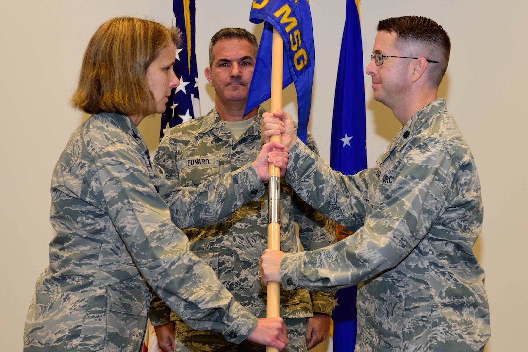Lt. Col. Rodney E. McCraine assumed command of the 403rd Mission Support Group during a ceremony presided over by Col. Jennie R. Johnson, 403rd Wing commander, at the Roberts Consolidated Aircraft Maintenance Facility at Keesler Air Force Base, Mississippi, Sept. 8, 2018. During the ceremony, McCraine said maintaining readiness is his top priority, and that to do so requires two main focuses: people and processes. (U.S. Air Force photo by Tech. Sgt. Ryan Labadens)