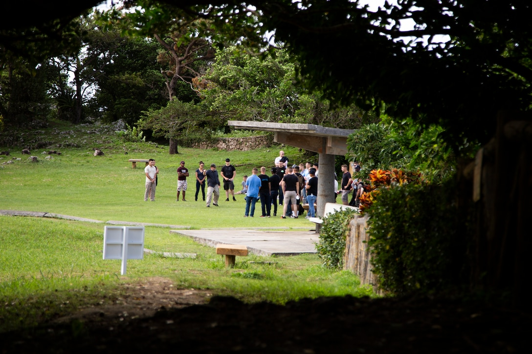 Chris Majewski, a tour guide, describes the details of the conflict on Hacksaw Ridge with Marines and Sailors during a tour Sept. 7, 2018 at Hacksaw Ridge, Okinawa, Japan. Marines and Sailors with Headquarters Company, Headquarters Regiment, 3rd Marine Logistics Group, participated in the World War II battle site tour to learn about the U.S. Marine Corps' history on Okinawa and remember those who have gone before them. Majewski is a tour guide with Marine Corps Community Services Tours+ and is a native of Boulder City, Nevada. (U.S. Marine Corps photo by Pfc. Terry Wong)