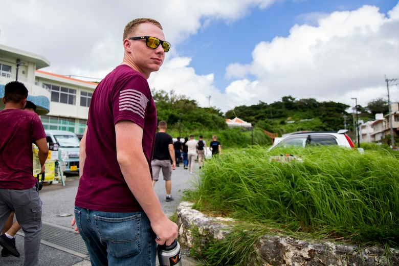 Cpl. Mackinley E. Dyess peers back at his fellow Marines during a tour Sept. 7, 2018 at Hacksaw Ridge, Okinawa, Japan. Marines and Sailors with Headquarters Company, Headquarters Regiment, 3rd Marine Logistics Group, participated in the World War II battle site tour to learn about the U.S. Marine Corps' history on Okinawa and remember those who have gone before them. Dyess is a radio technician with Jump Platoon, HQ Co., HQ Reg. and is a native of Fort Worth, Texas. (U.S. Marine Corps photo by Pfc. Wong)