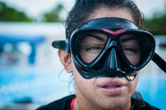 A female member of South Florida Tactical Athletes, a preparatory school for those looking to join special operations, learns to deal with water in her mask, August 8, 2018, at a pool in Plantation, Florida. The program is led by Lt. Col. (Dr.) Arnold T. Stocker, a clinical nurse with the 920th Aeromedical Staging Squadron who held two special operations careers as an Army Special Forces medical sergeant and Air Force Pararescueman. (U.S. Air Force photo by Tech. Sgt. Jared Trimarchi)