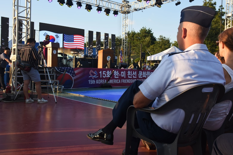 U.S. Air Force Col. Kevin Mantovani, 51st Mission Support Group commander, watches the upcoming performances during the opening ceremony of the 15th annual Korean-American Friendship Cultural Festival at the Songtan Entertainment District, Republic of Korea, Sept. 8, 2018. The two-day festival features traditional Korean and American food and entertainment to help both cultures learn more about each other. (U.S. Air Force photo by Tech Sgt. Ashley Tyler)