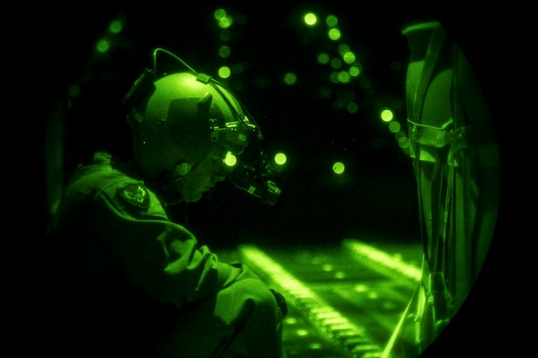 A U.S. Air Force loadmaster assigned to the 37th Airlift Squadron prepares to cut the restraints of a container delivery system to airdrop it from a C-130J Super Hercules over Romania, Aug. 28, 2018. The night operation was part of Carpathian Summer 2018, a bilateral training exercise designed to enhance interoperability and readiness of forces by conducting combined air operations with the Romanian air force. (U.S. Air Force photo by Senior Airman Devin Boyer)