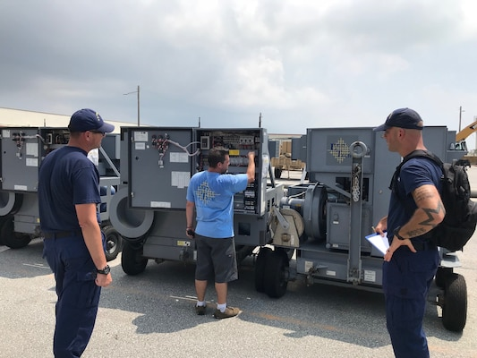 A Coast Guard forward inspection team screens the items before they are approved for shipment.