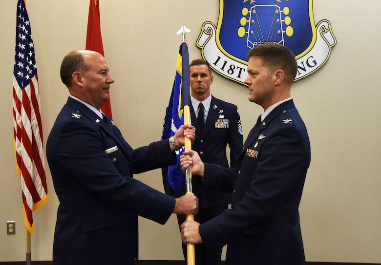 Col. Peter Geleskie, flight surgeon for the 118th Medical Group, receives the group's guide-on flag from Col. James Hagar, vice commander of the 118th Wing, in a change of command ceremony on Sept. 9, 2018 at Berry Field Air National Guard Base, Nashville, Tennessee.