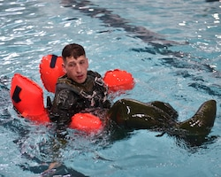 Reserve Citizen Airmen belonging to aircrews are required to know how to escape a parachute that is dragging them during emergency situations in open water.