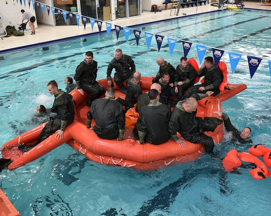 Reserve Citizen Airmen from the 757th Airlift Squadron mount a 20 man raft as a team during water survival training Hubbard Community Pool, September 9, 2018. During this training Airmen learn how to survive in emergency situations in open water and how to be rescued in combat and non-combat situations. (U.S. Air Force photo by Staff Sgt. Jeffrey Grossi)