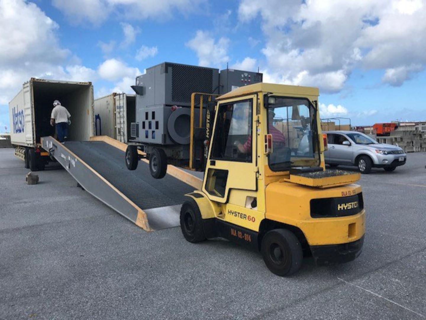 DLA Disposition Services employees provide the loading support to move the items into the shipping containers.