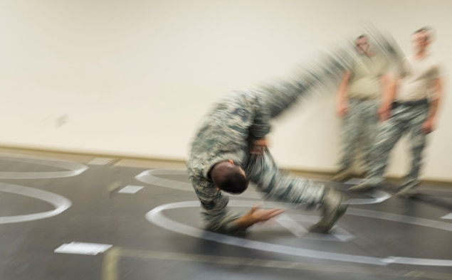 A U.S. Airman assigned to the 20th Security Forces Squadron performs a barrel roll during a combatives training at Shaw Air Force Base, S.C., Sept. 5, 2018.