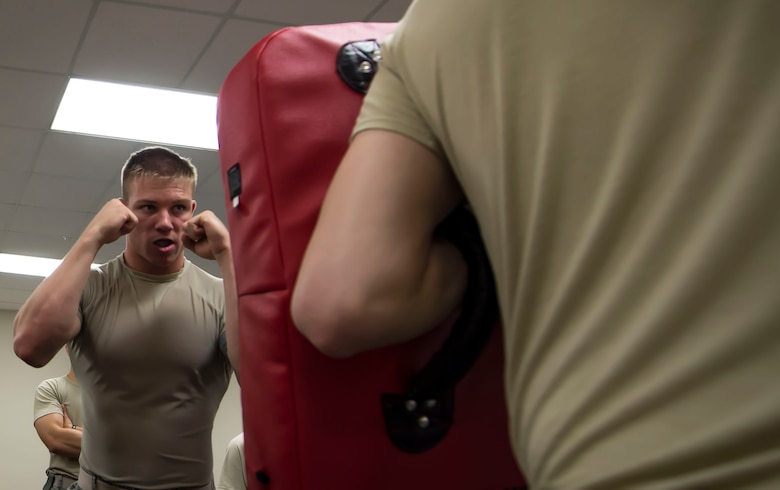 U.S. Air Force Airman Isaac Morrison, 20th Security Forces Squadron entry controller, prepares to hit a punching mat at Shaw Air Force Base, S.C., Sept. 5, 2018.