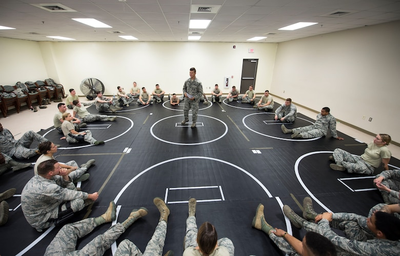 U.S. Air Force Staff Sgt. Barry O'Brien, 20th Security Forces Squadron combatives trainer, briefs Airmen during a combatives training at Shaw Air Force Base, S.C., Sept. 5, 2018.